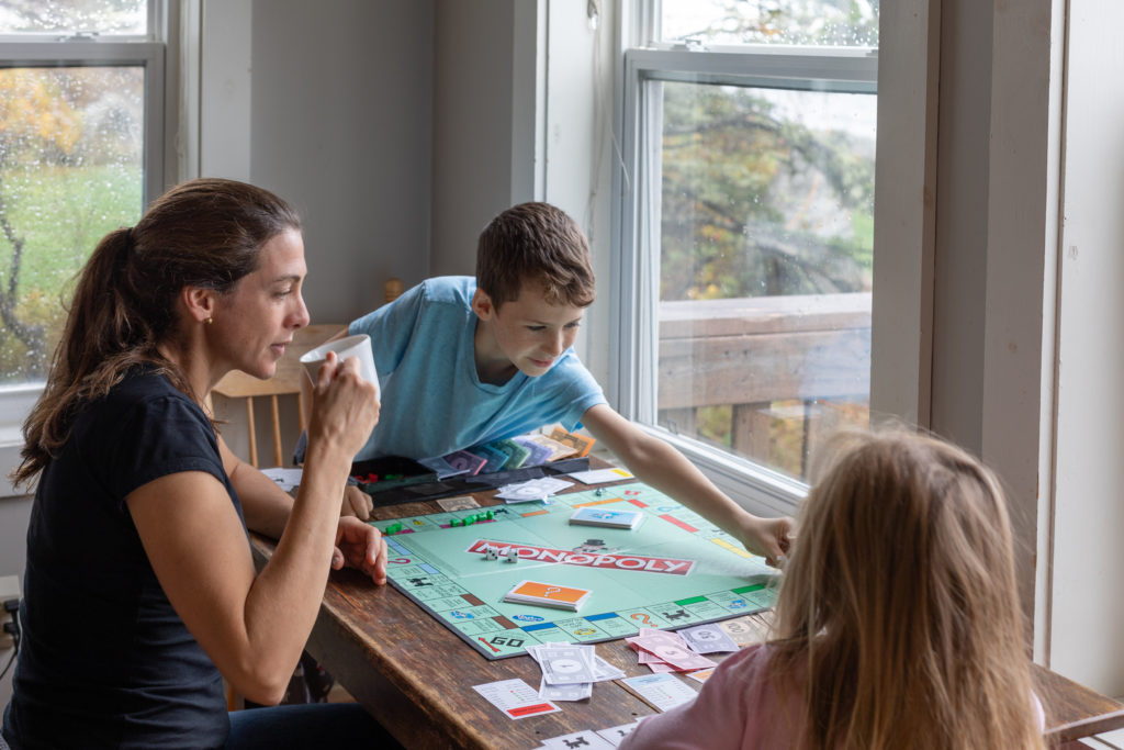 Spending a rainy day playing board games with the kids.