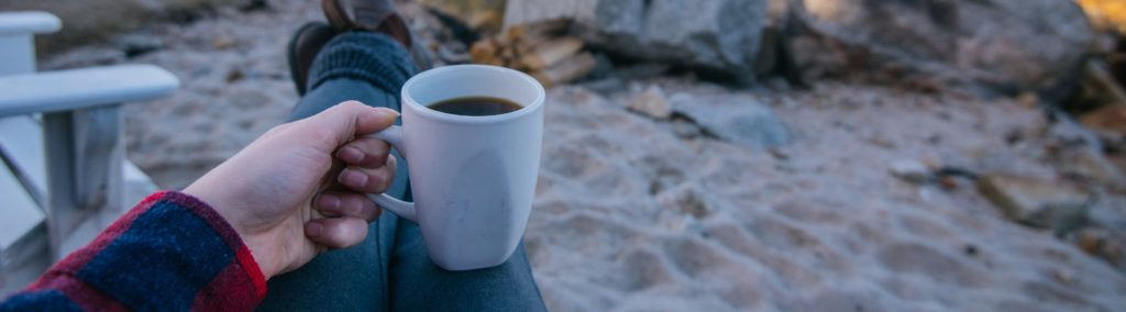 Enjoying a cup of coffee (in a regular mug!) early morning at one of our ocean front cottages.